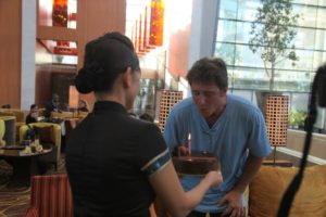 After touring the SkyPark, we celebrated Gary's birthday in the lobby with a delicious chocolate cake.