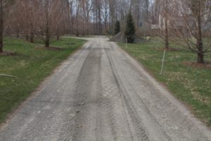 A sub-surface layer of bedding material is spread on the roads.