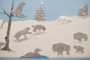 The tundra was made with felt and the scrub tree was felted with coarse gray wool roving.