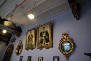 Hanging on the walls are elaborately framed portraits of generations of the Wee family, who owned the house.