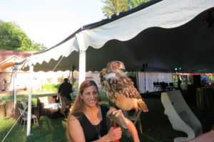 Falconer Jennifer Pena with Boo, the owl - Jennifer, who learned the art and science of falconry from her father, has been presenting educational programs since she was a teen.