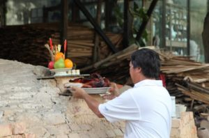The offerings are placed on the kiln's alter, honoring the God of the Kiln.