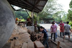 After the initial lighting, the TK staff got busy loading more wood into the kiln.