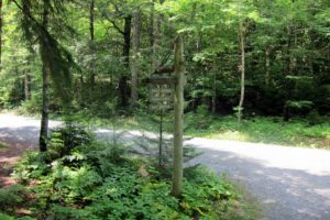 The old wooden signposts clearly mark the trails and roads.
