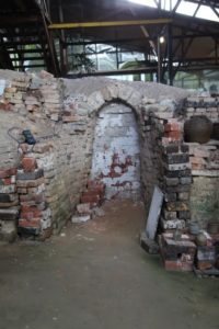 Pots are loaded into the kiln through a number of entrances, which are seal off before the kiln is lit.