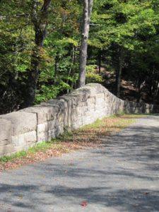 Rather than flattening hillsides to accommodate the roads, breast walls and retaining walls were built to save trees and to preserve the line of hillsides.