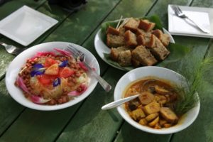 After our stroll through the farm, we were treated to a lovely snack outside.  I loved this green papaya salad, the banana bread, and the cooked plantains - all so wonderfully delicious!