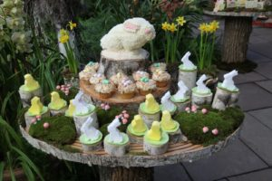Homemade marshmallo peeps and bunnies, coconut nest cupcakes, and a bunny cake - The natural moss was decorated with little toadstools for a craft store.