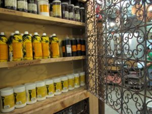 This cabinet contains vanilla products - extracts, powders, and syrups.