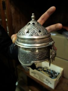 Atef shops for all sorts of curios, like fancy incense burners from Morocco.