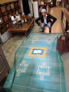 Atef unfolded one to reveal a beautiful Kilim carpet of silk and linen woven in Tunisia.