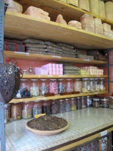 These shelves contain herbal skin products that are made in the Atlas Mountains of northern Africa.