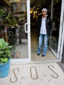 Atef, the owner of S.O.S, at the entrance to her shop