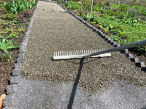 Next, is the gravel. I chose quarter-inch native washed stone. Each stone is about the size of a pea. The gravel is also spread evenly with a hard rake. The gravel and the stone dust are from Lawton Adams in nearby Somers, New York.