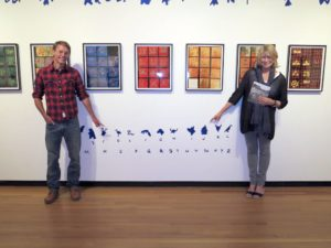 Posing with Daniel Dowd, a local Maine artist who painted all of Wegman's imagery onto the walls of the exhibit space.