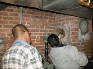 Meanwhile, in the basement, Kent Thuesen, my plumber and Joel were preparing the vent area for hookup to the PVC piping.