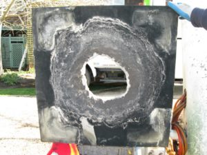 It was soon discovered that the cap actually needed replacement.  After years of venting, a hole had worn through the slate.