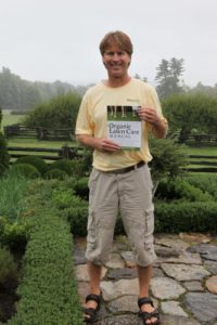 Paul Tukey posing with a copy of his book - The Organic Lawn Care Manual