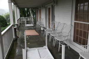 We had prepared for the storm for a few days.  All lighter furniture was stored in barns and garages and smaller potted plants were also put away.  This porch furniture remained intact.
