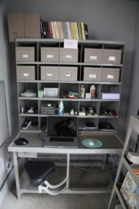 My desk in the greenhouse - an old postal sorting desk