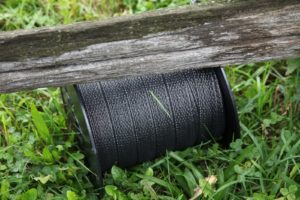 Safe-Fence webbing, a combination of stainless steel wire and polyethylene, comes as a flat tape.