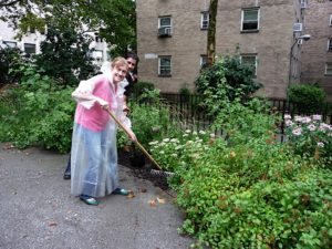 Jean Graham and Anthony Lucia shoveling and raking away