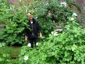 Andrew Beckman, gardener extraordinaire, standing proudly amidst his glorious work.