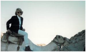 This book got me thinking of my visit to Egypt in 1996 with some friends and my nieces and nephews.  Here I am riding through the Saqqara Desert on a camel.