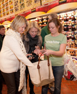 Shopping with Memrie Lewis and Heather Kirkland from the events department - Dan Glickberg helped us find some specialized yogurts and milks before we went to tour their amazing wine shop. Photo Credit - Bill Hilson