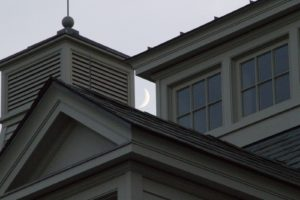 Architectural details of the stable with a setting crescent moon