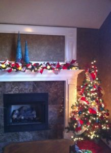 Amber Roberts from Springdale, AR decorated her tree and mantle using red ribbon and white lights.