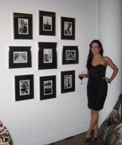 """Stephanie Roberts with her photographs """"le bien voyagé romantique."""""""