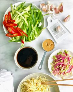 "And don't forget all the great recipes from our own director of food development and host of ""Kitchen Conundrums,"" Thomas Joseph. These ingredients are for peanut noodles - peanut butter, soy, rice vinegar, garlic, sesame oil, vegetables, and store-bought spaghetti."
