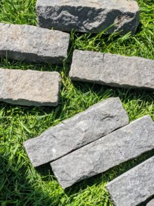 Each black granite brick measures eight inches long by about two inches wide and two inches thick.