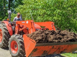 Meanwhile, Pete gets a bucket load of good, nutrient rich mulch from the compost pile here at the farm. He uses our Kubota model M7060HD12 tractor – a vehicle that's used daily for hauling mulch, equipment, and so much more.