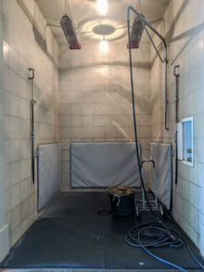 The shower stall is located at one end of my stable. It is a large stall with padded lower walls for the equines' safety. The faucets are housed in the cabinet on the right to keep them out of the way. The shower stall is also equipped with heaters suspended from the ceiling if needed.