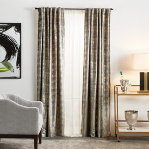 The Monroe Grey Abstract Semi-Sheer Rod Pocket Curtain Panels in 84-inch or 95-inch lengths feature a delicate metallic all-over pattern set to an inviting gray or blush velvet. These window panels are easy to put up and add instant sophistication to any room.