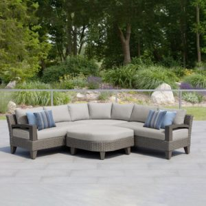 Here is my Oakland Patio 5 Piece Rattan Sectional Seating Group with Cushions. Fashioned from a durable light grey aluminum frame with UV-resistant woven light grey resin wicker detailing, this sectional sofa is designed around two loveseats with single armrests plus a corner. Two triangular ottomans can be used as individual footrests or grouped together as a rhombus-shaped coffee table.
