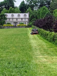 We're doing a lot of mowing at the farm. Here's Pete mowing the paddock in front of my Winter House in the distance. He is using the ZD1211-60 zero turn riding mower. It has a 24.8 horsepower diesel engine and a wider mower deck than older models. It gets a lot of use this time of year.
