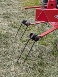 "The tedder uses these moving forks to aerate or ""wuffle"" the hay and speed up the process."