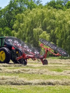 After the hay is tedded, it is then raked. Raking the hay is easily the fastest part of the process. The rake is used to create more windrows that the baler can pick up.