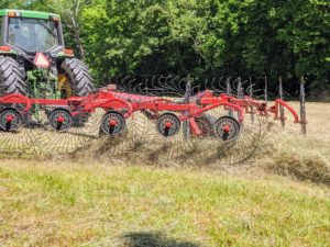 This is the rotary rake, which picks up the cut and drying hay once again and rakes it into more windrows.