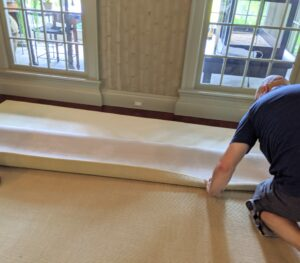 To help flatten the carpet, the edges are rolled in the opposite direction.