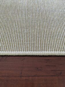 Carpet edges are often bound with fabric. I prefer my carpet edges serged liked this. Serging wraps yarn continuously around the edge.