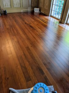 After the old carpeting is removed, the floors are cleaned of any dust and stuck on old padding. Then the floors are polished with a rotary floor buffer.