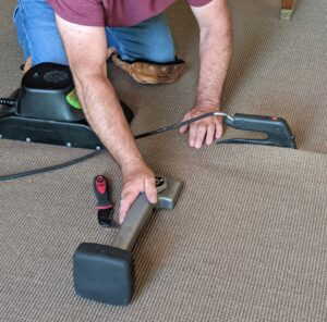 The carpet kicker is used again to stretch the carpet where needed.