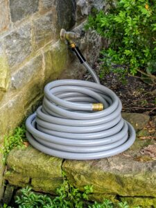 And this brand new hose is located just outside my Winter House porch behind one of the giant boxwood shrubs on the terrace parterre.