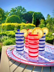 Under these festive glasses is my sturdy melamine platter decorated with a star motif and bold red-striped border. You can use it to serve up cool drinks, hot dogs, burgers, and even ribs in patriotic style.