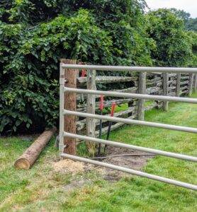 The fence is now secure. Pete lubricates the gate joints so it opens and closes smoothly and quietly.
