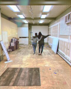 Here, Megan and Caroline look at the new walls and back of the shop as the transformation continues.